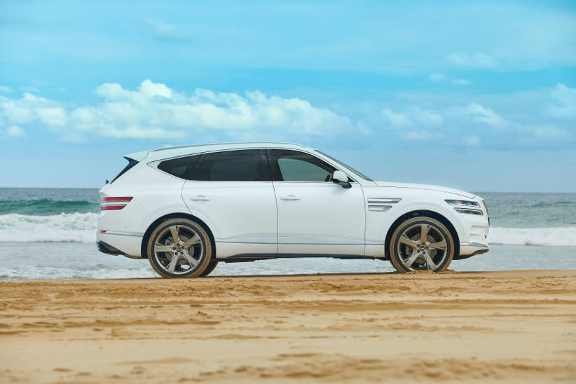 The Genesis GV80 SUV luxury car at the beach