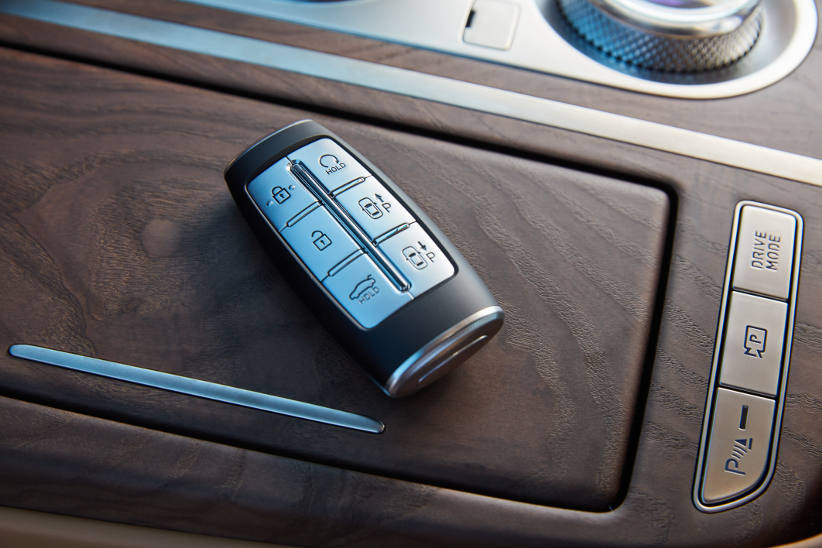 A fancy looking car key for the Genesis G80