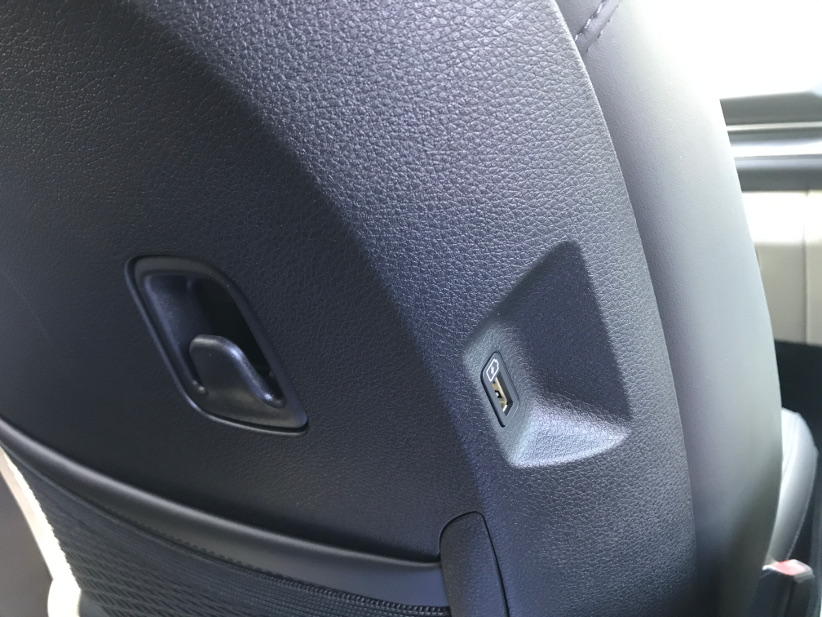 The Carnival has a curry hook and USB power on the back of passenger's seat