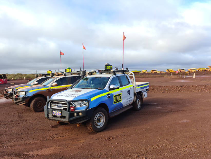 Autonomous Ford Ranger fleet driving around mine site